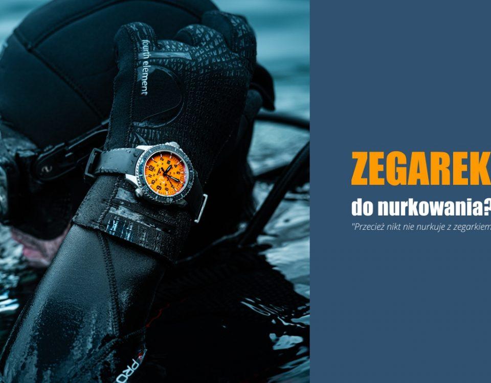 Nurek w skafandrze oraz akwalungu wynurzający się z wody z zegarkiem traser SuperSub Orange na nadgarstku